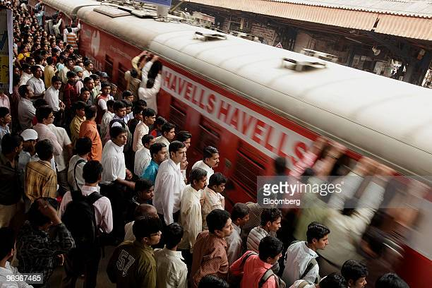 Commuters wait to board a train in Mumbai India on Monday Feb 22 2010 Railways Minister Mamata Banerjee will present the investment and revenue...