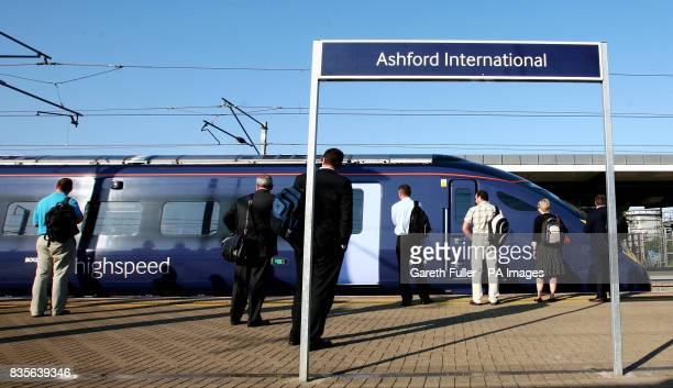 Commuters wait to board the first 648am high speed javelin train service from Ashford International Station in Kent to London which begins today