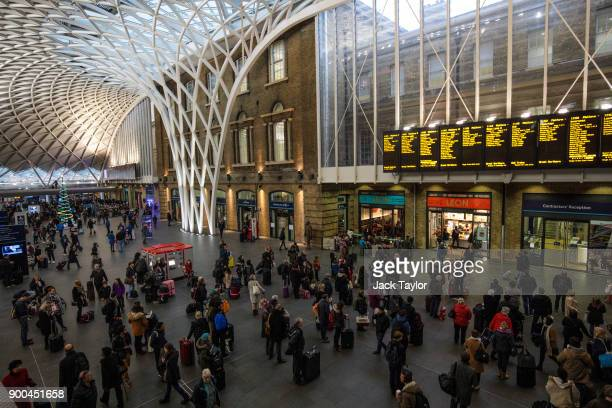 Commuters wait to board trains at King's Cross Station on January 2, 2018 in London, England. The average cost of a rail ticket has risen by 3.4%...