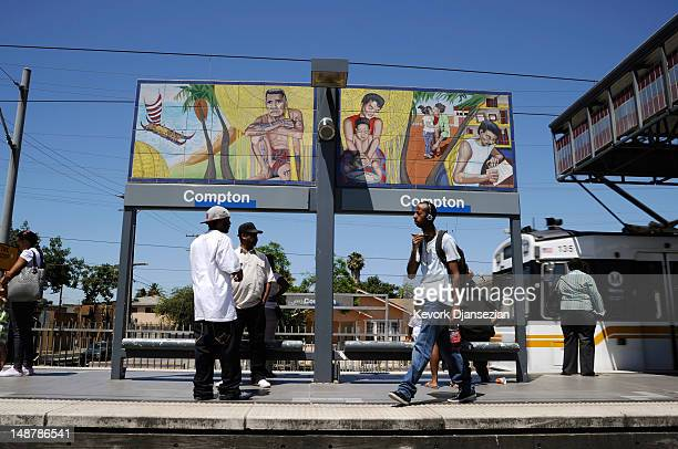 Commuters wait to take a ride on a LA Metro rail station on July 19 2012 in Compton California The City of Compton located south of Los Angeles with...