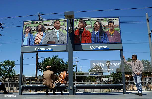 Commuters wait to take a ride on a LA Metro train at the a rail station on July 19 2012 in Compton California The City of Compton located south of...