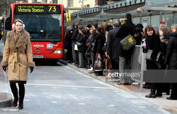 Commuters wait to travel on a bus outside Victoria Station as workers on the London Underground stage a fourth 24 hour strike on November 29 2010 in...