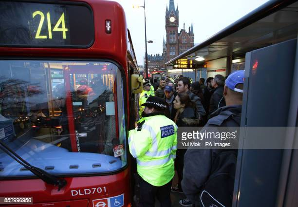 Commuters waiting at a bus stop at King's Cross station during the London Underground workers strike over planned job cuts and ticket office closures...
