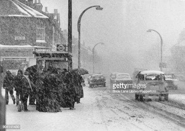 Commuters waiting at a bus stop in Tooting south London after a snowstorm hit the south of England 8th January 1982