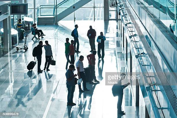commuters waiting at airport subway station in Dubai