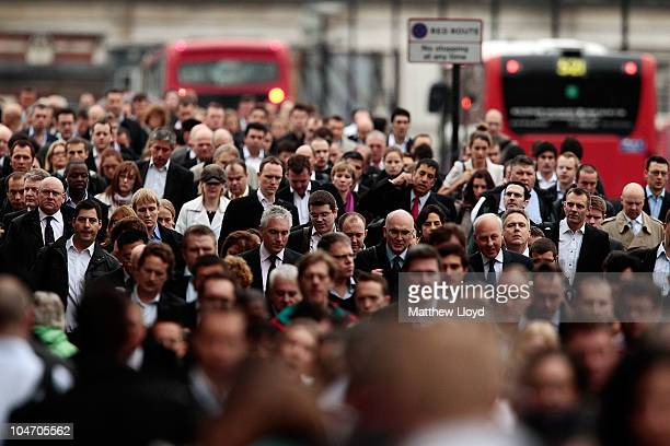 Commuters walk across London Bridge during morning rush hour on October 4 2010 in London England London Underground workers are staging a 24 hour...