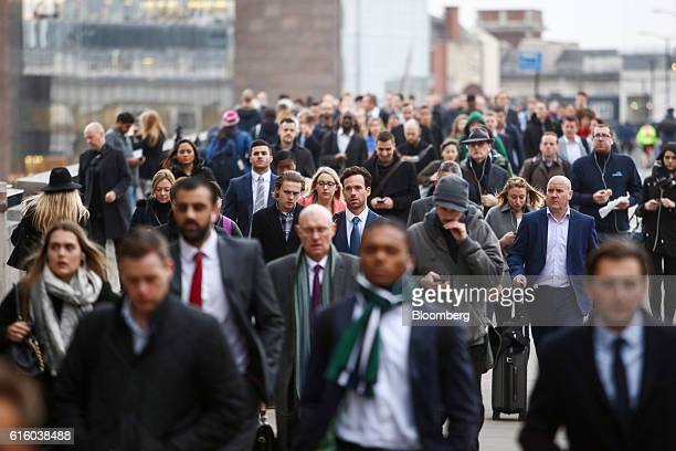 Commuters walk across London Bridge in London UK on Friday Oct 21 2016 London the city of almost 9 million people is the 'soft power capital of the...