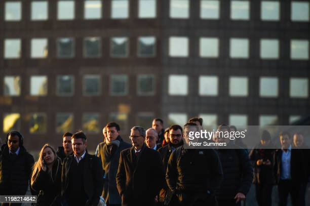 Commuters walk across London Bridge on February 3 2020 in London England People returned to work today Monday after Britain's departure from the...