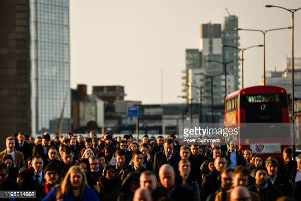 Commuters walk across London Bridge on February 3, 2020 in London, England. People returned to work today, Monday, after Britain's departure from the...