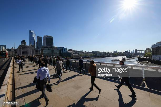 Commuters walk across London Bridge towards the City of London square mile financial district in London, U.K., on Thursday, May 27, 2021. More than...