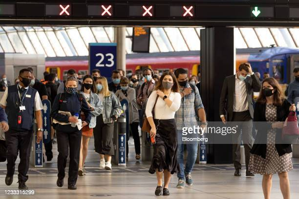 Commuters walk along the concourse after arriving at London Waterloo railway station in London, U.K., on Monday, June 7, 2021. Flexible office firm...