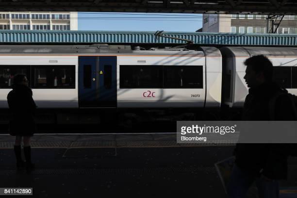 Commuters walk along the platform as a C2C passenger train departs Barking Station in Barking, U.K., on Monday, Feb. 13, 2017. Trenitalia SpA in...
