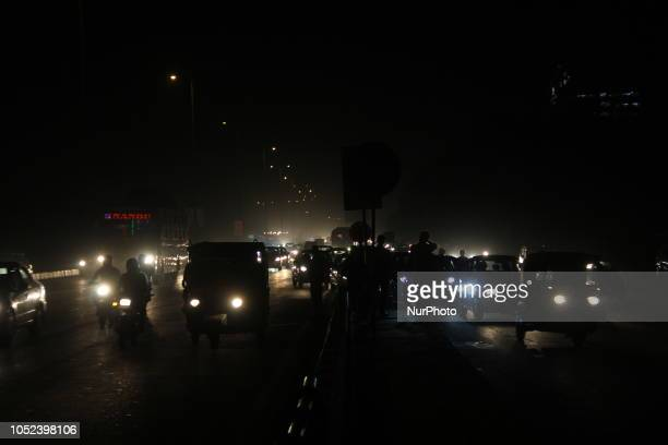 Commuters walk amid Smog in New Delhi India on 17 October 2018 Pollution and smog are annual features of the winter in New Delhi and the larger...