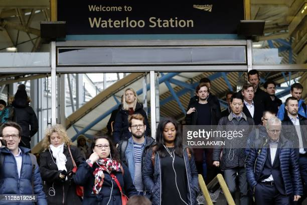 Commuters walk at Waterloo station in central London on March 6 a day after a suspicious package was found at the station British counter terrorism...