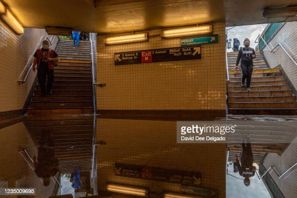 Commuters walk into a flooded 3rd Avenue / 149th st subway station and disrupted service due to extremely heavy rainfall from the remnants of...