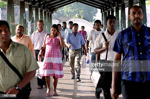 Commuters walk near Fort Railway Station in Colombo Sri Lanka on Wednesday Dec 7 2011 Sri Lankan inflation slowed in November to a 16month low of 47...