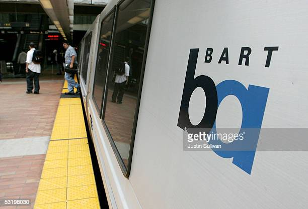 Commuters walk off of a Bay Area Rapid Transit train July 5 2005 in San Francisco California With a strike deadline looming at the end of the July 5...