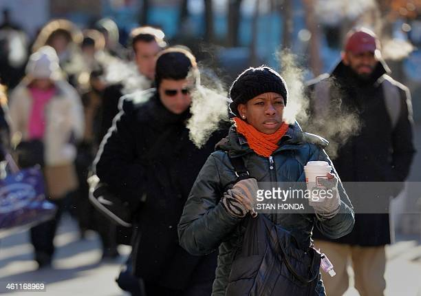 Commuters walk on the east side of Manhattan January 7 2014 in New York as frigid weather grips the northeast A blast of bonechilling cold snarled...