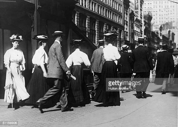 Commuters walk on the street after leaving a subway station New York 1910s