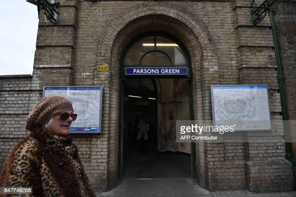 Commuters walk outside Parsons Green station which was reopened in the early hours of the morning following a bomb attack on a packed underground...