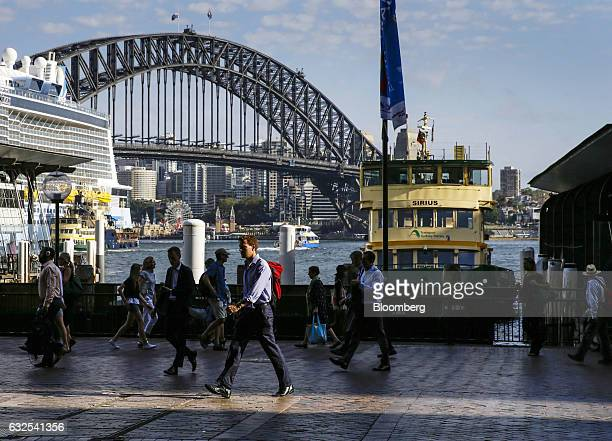 Commuters walk past a ferry docked at the Circular Quay wharf in Sydney Australia on Monday Jan 23 2017 Australia is leading a push to salvage a...