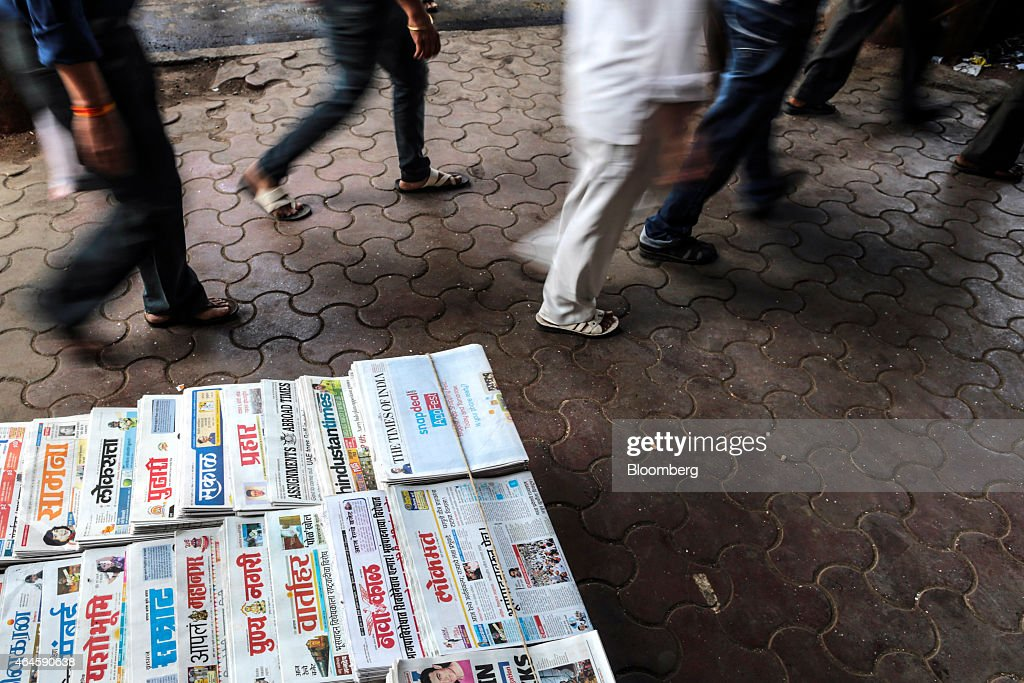 Commuters walk past a newspaper stall outside Chhatrapati Shivaji Terminus railway station during the morning rush-hour in Mumbai, India, on Thursday, Feb. 26, 2015. India's Finance Minister Arun Jaitley will present this year's budget on February 28. Speculation that Prime Minister Narendra Modi's policies will boost economic growth has propelled India's Sensex to the world's third-biggest gain among major markets during the past 12 months. Photographer: Dhiraj Singh/Bloomberg via Getty Images