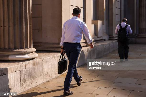 Commuters walk past the Bank o England in the City of London, U.K., on Thursday, Aug. 5, 2021. The Bank of England may move a step closer to...