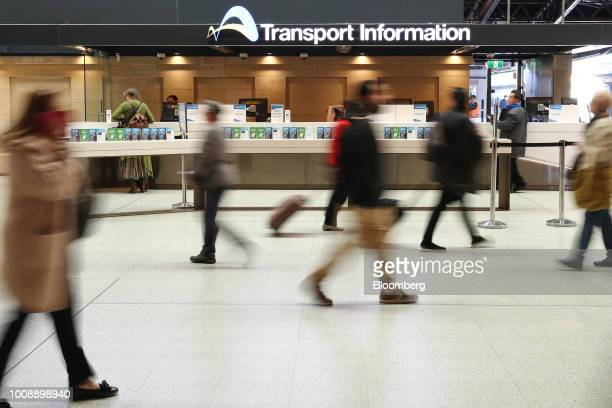 Commuters walk past the Customer Service Centre operated by NSW Transport on the grand concourse at the Central station in Sydney Australia on Monday...