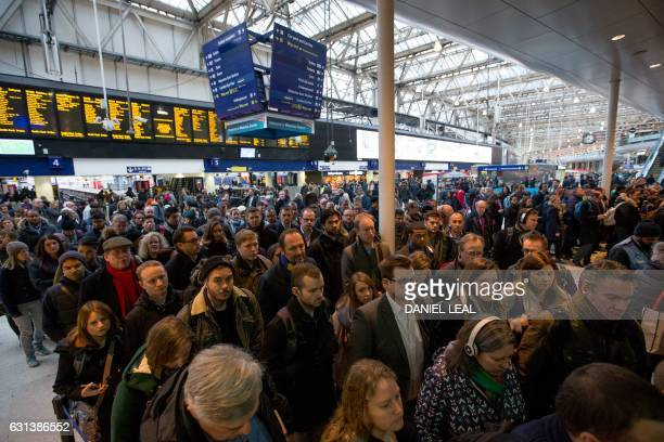 Commuters walk through London Waterloo station in London on January 10 2017 after strike action by Southern Rail caused another morning of travel...
