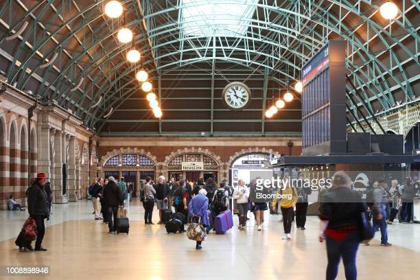 Commuters walk through the Grand Concourse at Central Station in Sydney Australia on Monday July 30 2018 The nation whose fiscal year ends on June 30...