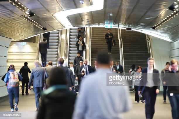 Commuters walk through the Wynyard Walk pedestrian tunnel at Wynyard railway station in Sydney Australia on Monday July 30 2018 The nation whose...