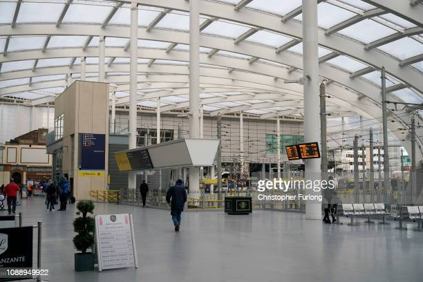 Commuters walk through Victoria Station during heightened security after the stabbing on Monday January 02 2019 in Manchester England A police...