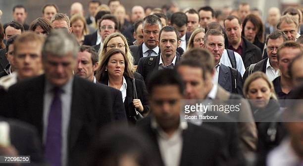Commuters walk to work over London Bridge on October 5 2006 in London England