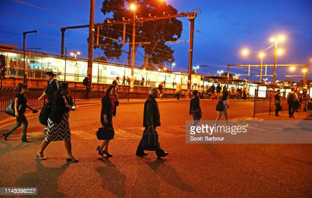 Commuters walk towards trains and buses at Glen Waverley station in the electoral division of Chisholm on April 17 2019 in Melbourne Australia The...
