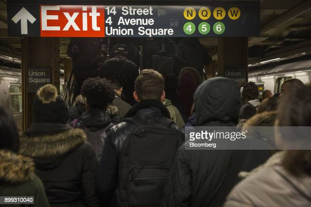 Commuters walk up stairs at the 14th StreetUnion Square subway station in New York US on Thursday Dec 21 2017 New York's Metropolitan Transportation...