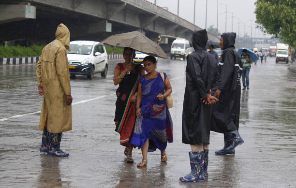 IND: Heavy Rain Lashes Delhi-NCR, Traffic Snarls, Congestion In Various Parts