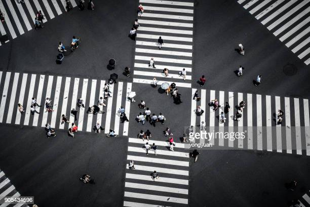 commuters walking at a crossing in ginza - crossroad stock pictures, royalty-free photos & images