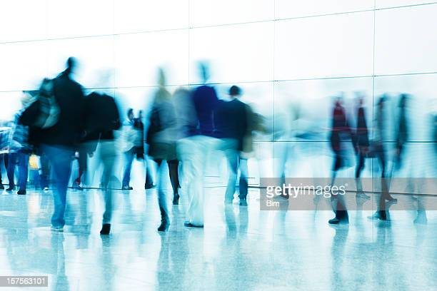 commuters walking in corridor, blurred motion - blurred motion stock pictures, royalty-free photos & images