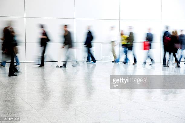 commuters walking in corridor, blurred motion - female streaking stock pictures, royalty-free photos & images