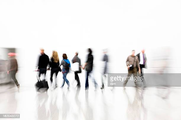 Commuters Walking in Corridor, Pulling Luggage, Blurred Motion