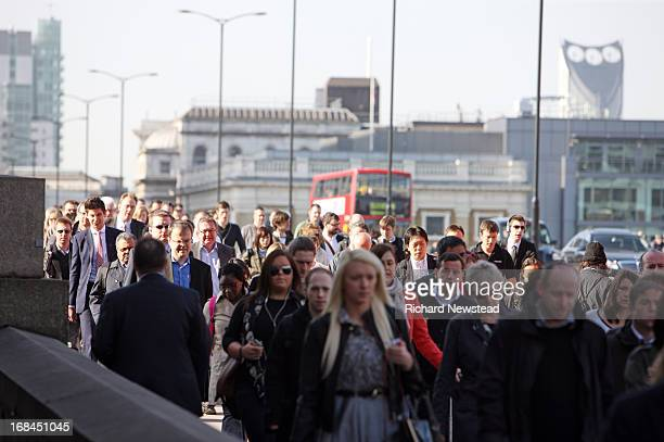 Commuters walking over London Bridge on a sunny morning. London, 3rd May 2013