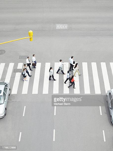 commuters walking seen from above - zebra crossing stock pictures, royalty-free photos & images