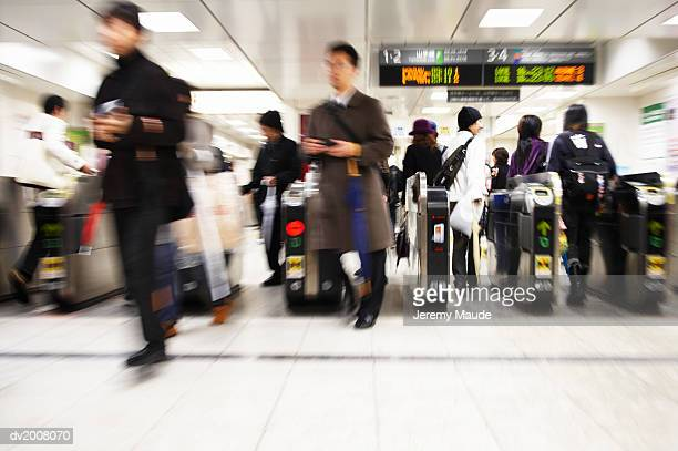 commuters walking through turnstiles, japan - 改札 ストックフォトと画像