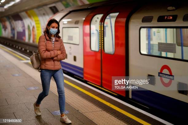 Commuters wear facemasks as they travel on the London Underground in London on June 12 2020 as lockdown measures are eased during the novel...