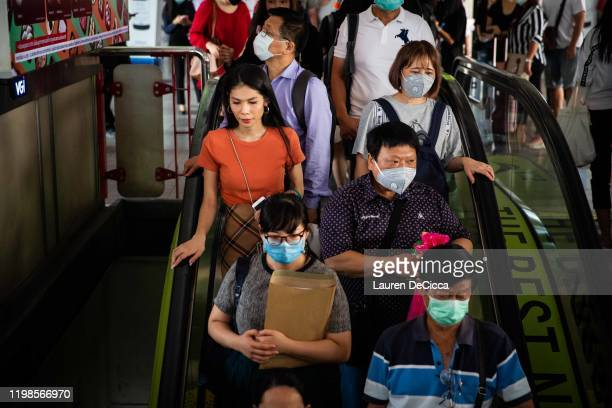 Commuters wear masks on the BTS sky train on February 4 2020 in Bangkok Thailand Thai people and tourists wear masks as the Coronavirus cases in...