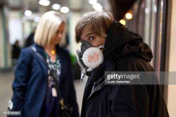 Commuters wearing a face protection mask travels on the underground on March 23 2020 in London United Kingdom Coronavirus pandemic has spread to at...