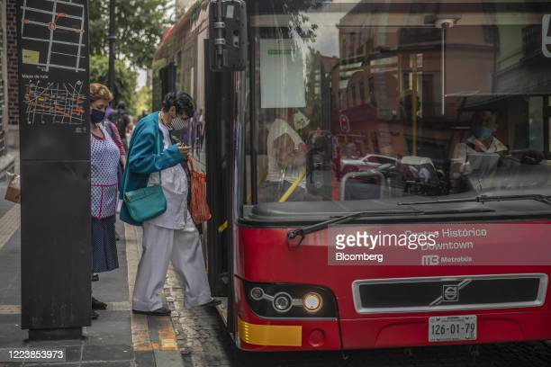Commuters wearing protective masks enter a bus in Mexico City Mexico on Wednesday July 1 2020 Throughout the coronavirus pandemic Mexico and parts of...
