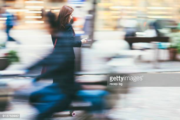 commuting businesswoman - motion blur stock photos and pictures