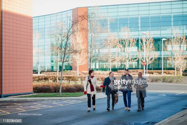 commuting coworkers - business community stock pictures, royalty-free photos & images