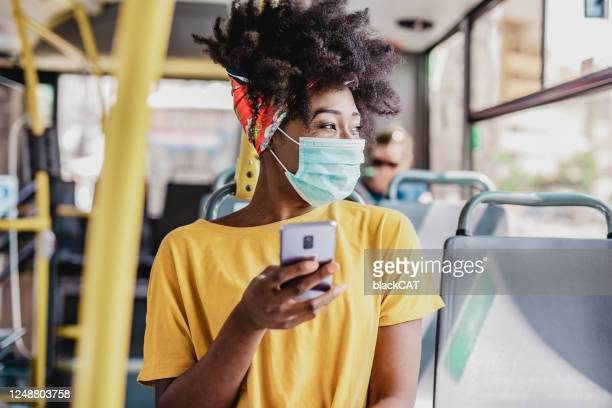 commuting during a pandemic - cat face mask stock pictures, royalty-free photos & images